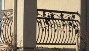 Arced Metal Balusters with Metal Vines