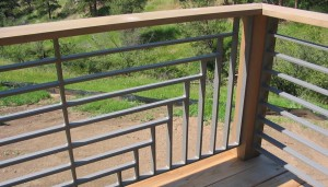 Intersecting Horizontal and Vertical Metal Slat Railing