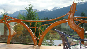 Log Branch Railing with Glass Panels