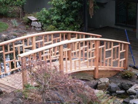 Asian Inspired Curved Bridge and Geometric Wood Railing ...